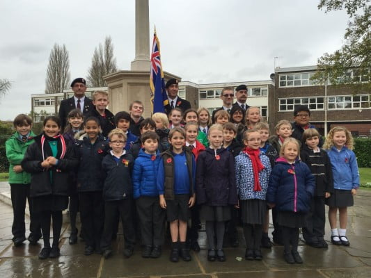 School children, standard bearer, war memorial, Armistice Day 2014.