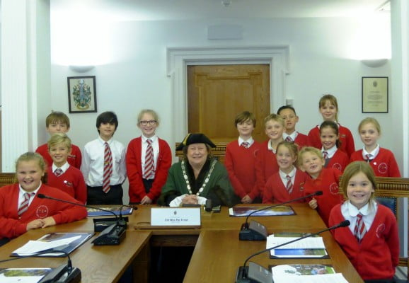 Children with the Mayor in the council chamber