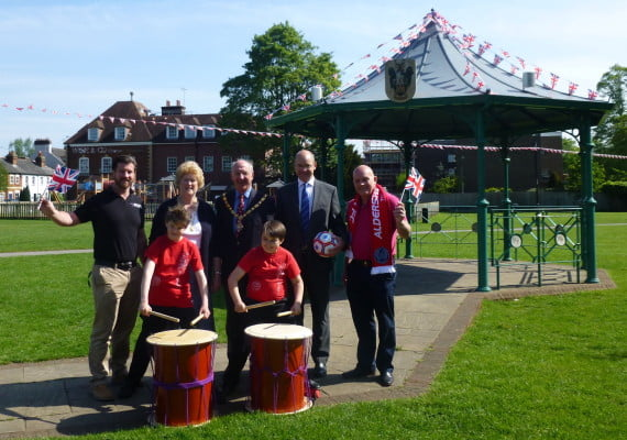 The Mayor and Mayoress of Farnham, Cllr John and Gillian Ward with taiko drummers and representatives from the Spring Festival's sponsors Trueman & Grundy and Anytime Fitness.