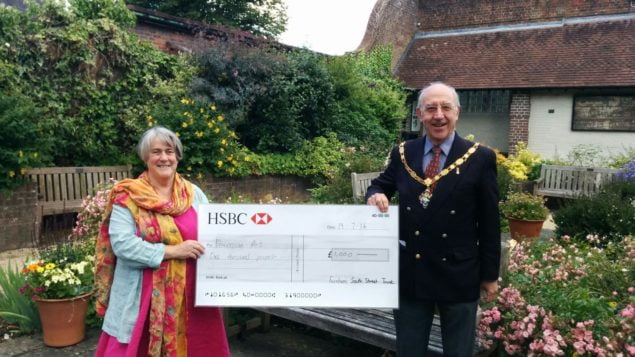 Caption: The Mayor of Farnham, Cllr John Ward presents a cheque to Jo Aylwin.
